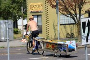 Man on Bike with Trailer